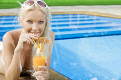 Pooling. Portrait of young attractive woman having good time in tropic environment Stock Photos
