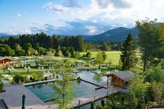Pools and bathing lakes of Hotel and Resort Sonnenalp, Allgau, Bavaria, Germany royalty free stock image