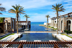 The pools and beach at luxury hotel Royalty Free Stock Photo