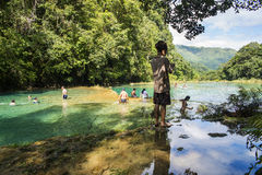 Pools and tourists in Semuc-champey. A scenic photo of the amazing pools of Semuc-champey with tourists taking their bath or pics Royalty Free Stock Images
