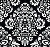 Pools volkskunst wit naadloos patroon op zwarte - wzory lowickie, wycinanki Stock Afbeeldingen