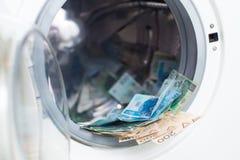 Pools witwassen van geld Stock Afbeeldingen