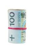 Poolse bankbiljetten van 100 PLN die met rubber worden gerold Stock Fotografie