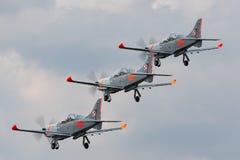 Poolse Luchtmacht PZL-Okecie pzl-130 tc-1 Orlik-schroefturbine, enige motor die, twee vliegtuigen van de zeteltrainer in vorming  Royalty-vrije Stock Foto