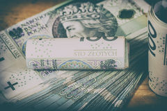 Poolse munt PLN, geld Dossierbroodje van bankbiljetten van 100 PLN P Stock Foto