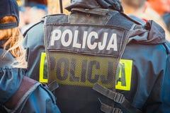 Poolse politieman, achtermening Stock Afbeeldingen