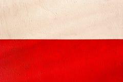 Poolse vlag met de textuur van pleistermuur Stock Afbeeldingen