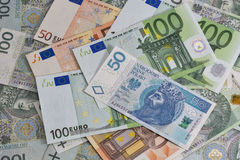 Poolse zloty en Euro nota'sachtergrond Royalty-vrije Stock Fotografie