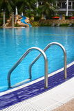 Poolside. Luxury hotel poolside and ladder Royalty Free Stock Photography