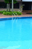Poolside. Luxury hotel poolside and ladder Royalty Free Stock Photos