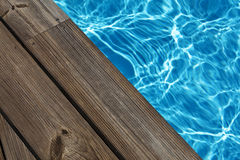 Poolside. Calm and empty swiming pool, deck detail Stock Images
