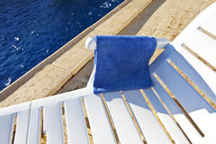 Poolside. Swiming pool with bed and towel Stock Photography