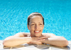 Poolside. Smiling woman at poolside Stock Images