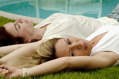 Poolside beauties. Two cute young women near the poolside Stock Photo