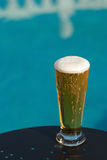 Poolside beer Royalty Free Stock Image