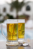 Poolside beer Stock Photography