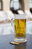 Poolside beer Royalty Free Stock Photos