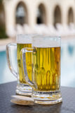 Poolside beer Royalty Free Stock Photography