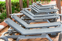 Poolside benches in line Stock Image