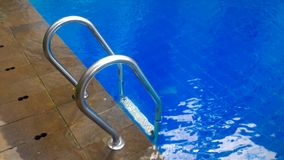 By the poolside. Blue colored water in a swimming pool, poolside, summer, lifesyle stock images