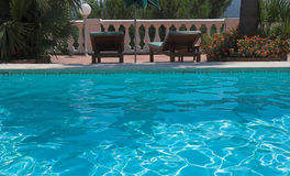 Poolside at bormes les mimosas. Royalty Free Stock Images