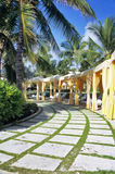 Poolside Cabana Row. A row of brightly coloured cabanas await tourists seeking rest and relaxation on Great Exuma Island in the Bahamas royalty free stock photography