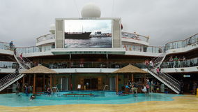 Poolside on the Carnival Breeze. The Breeze is a Dream-class cruise ship owned by Carnival Cruise which entered service in June 2012 Stock Photography