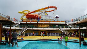 Poolside on the Carnival Breeze. The Breeze is a Dream-class cruise ship owned by Carnival Cruise which entered service in June 2012 Stock Photos