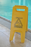 Poolside caution sign Royalty Free Stock Photo