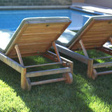 Poolside chairs. Pair of chairs sitting beside pool royalty free stock photos