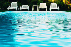 Poolside chairs Royalty Free Stock Images