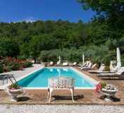 Poolside at classic mansion pool and garden. The pool area at a mansion in italy Royalty Free Stock Photography