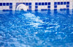 Poolside with clear blue water royalty free stock photography