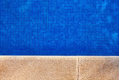 Poolside with clear water royalty free stock photography