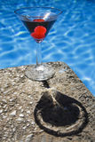 Poolside Cocktail with Shadow. Poolside martini with red cherries and attractive shadow Stock Photography