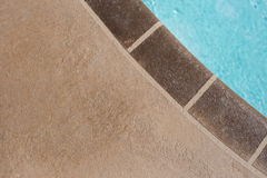 Poolside. Decorative Concrete next to a swimming pool Stock Image