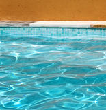 Abstract detail of poolside. Detail of poolside against an orange plastered wall royalty free stock images