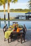 Poolside dinner Stock Photo