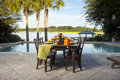 Poolside dinner. Table set up for dinner at poolside and waterfront stock photography