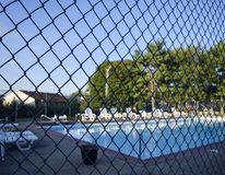 Poolside. Through fence Royalty Free Stock Image