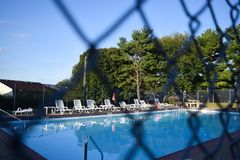 Poolside. Through fence Stock Image