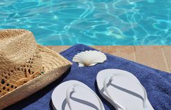 Poolside holiday scenic. Cowboy hat pool summer flip flop thong towel Royalty Free Stock Image