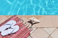 Poolside holiday scenic sandals thongs Stock Image