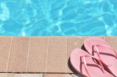Poolside holiday scenic sandals thongs Royalty Free Stock Photography