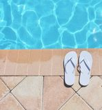 Poolside holiday scenic sandals thongs Royalty Free Stock Photos