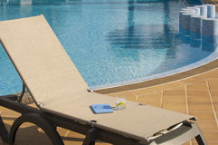 Poolside Lounge Chair With Drink and Tablet Stock Photo