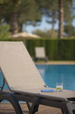 Poolside Lounge Chair With Drink and Tablet Royalty Free Stock Images