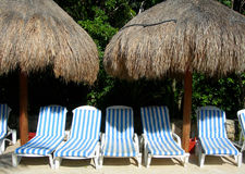 Poolside lounge chairs Royalty Free Stock Image