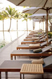 Poolside loungers. At an exotic asian hotel royalty free stock photography