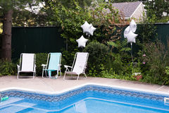 Poolside loungers Royalty Free Stock Photos